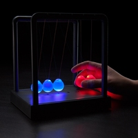Kinetic Light Newton Cradle